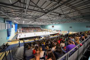 view from the back row of spectators looking towards a sports court