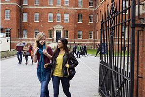 two students walking through the gates at the charles hastings building
