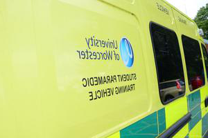 An ambulance used on our paramedic science degree with student paramedic training vehicle written on the side.