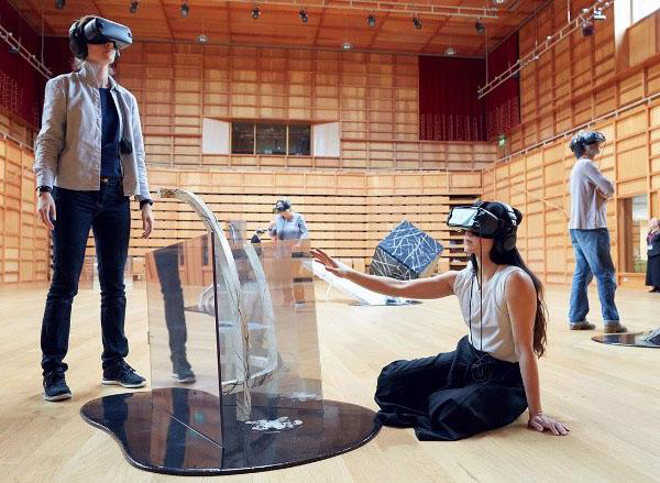 Several people are wearing virtual reality helmets