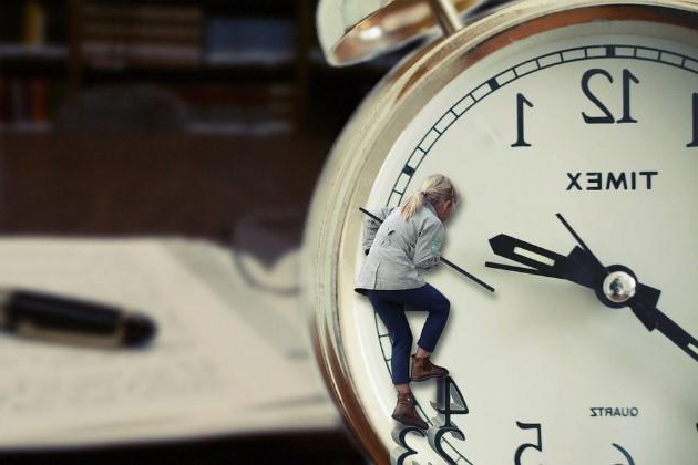 A woman trying to save time by climbing a clockface