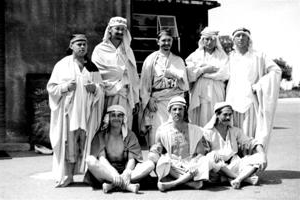 eight sheikh men st和ing in a group