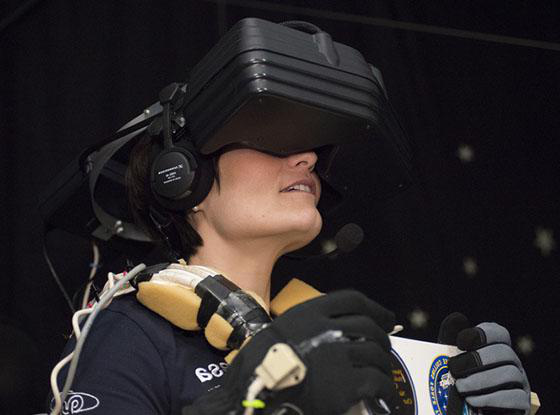 A woman plays a game with a VR headset on