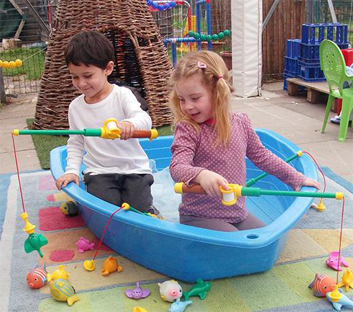 Unitots children play in a boat