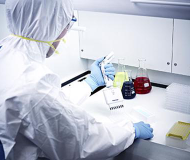 Man in lab coat blue gloves at a white desk