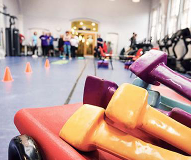 inside a sports hall with colourful equipment in the foreground